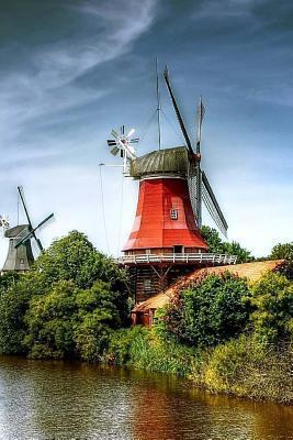 Windmills by a Strea...