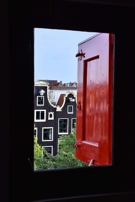 Looking Out at Amsterdam from a Window With a Red Shutter European Journal