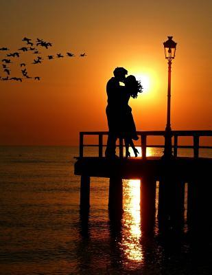 Lovers Kiss at Sunse...