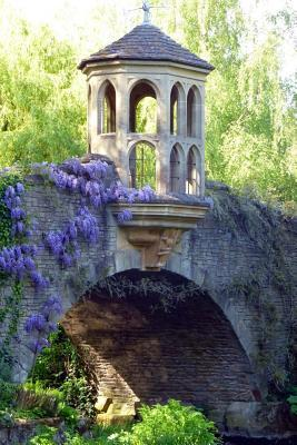 A Stone Bridge Draped With Purple Wisteria in a Formal Garden Lined Journal